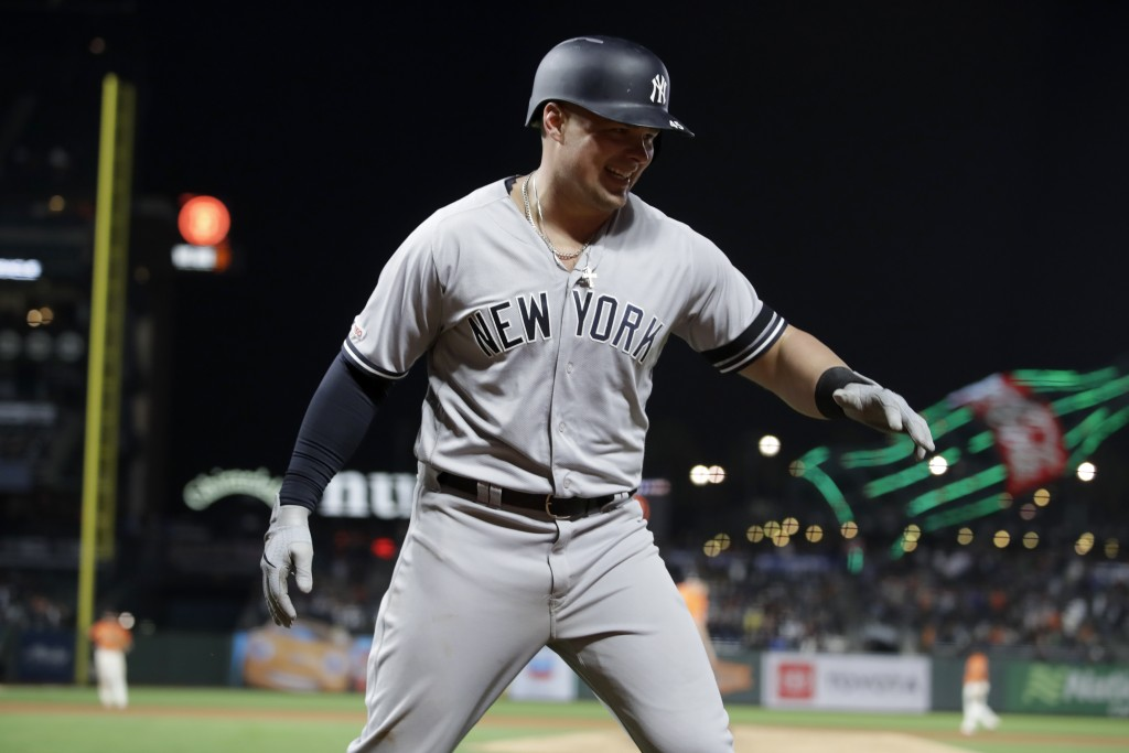 New York Yankees' Luke Voit celebrates after hitting a two run home run off San Francisco Giants' Mark Melancon in the ninth inning of a baseball game