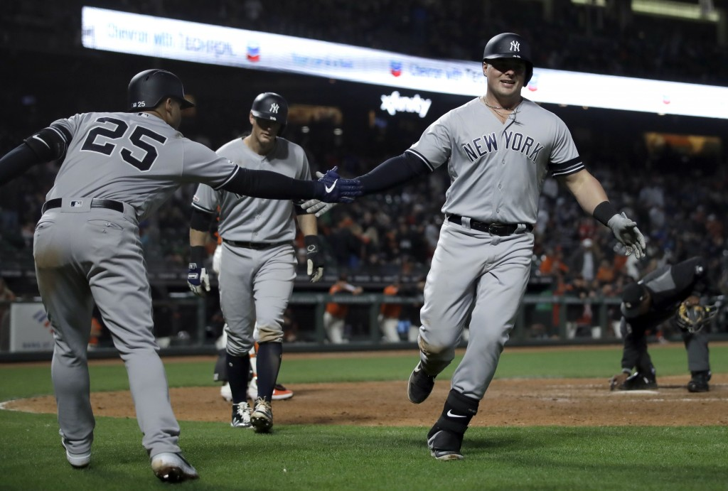 New York Yankees' Luke Voit, right, is congratulated by Gleyber Torres (25) after hitting a two run home run off San Francisco Giants' Mark Melancon i
