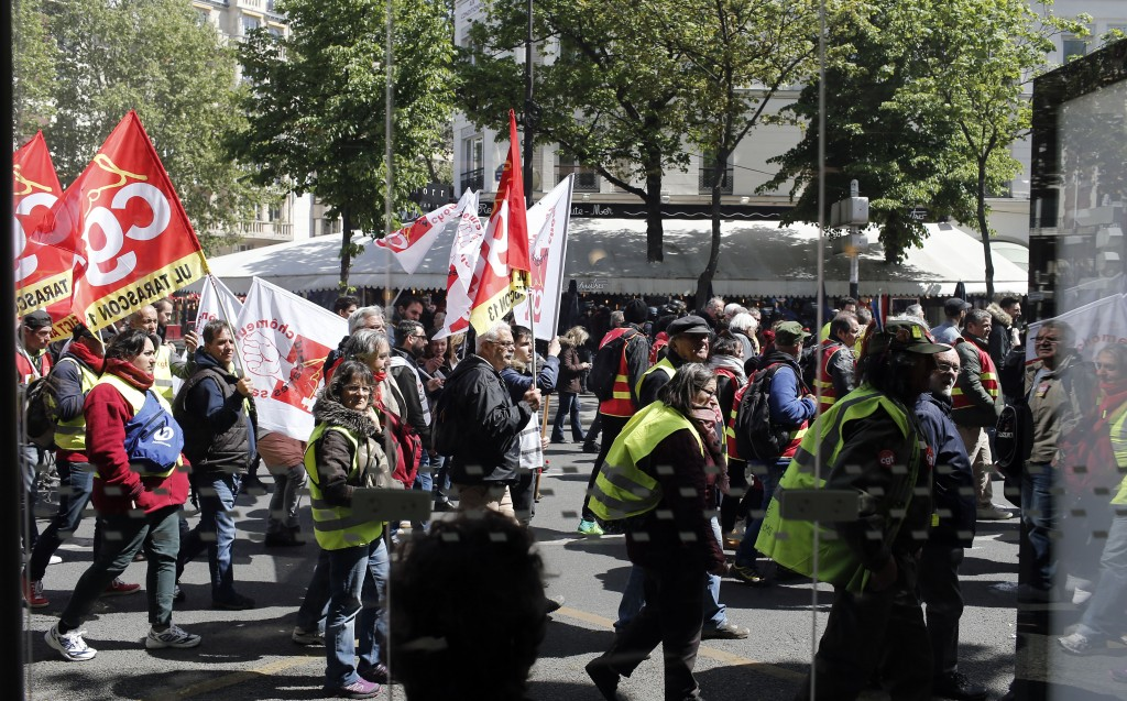 Yellow Vest demonstrators march in Paris, during another protest Saturday April 27, 2019. Yellow vest protesters remain a force in French politics des...