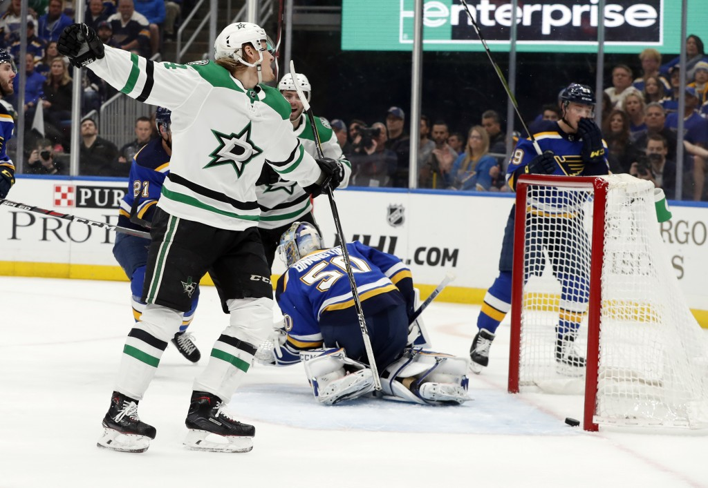 Dallas Stars' Roope Hintz, of Finland, left, celebrates after scoring past St. Louis Blues goaltender Jordan Binnington (50) during the first period i...