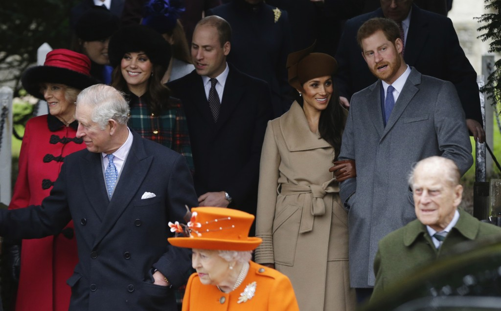 FILE - In this Monday, Dec. 25, 2017 file photo, front from left: Britain's Prince Charles, Queen Elizabeth II and Prince Philip. Rear From left, Cami...
