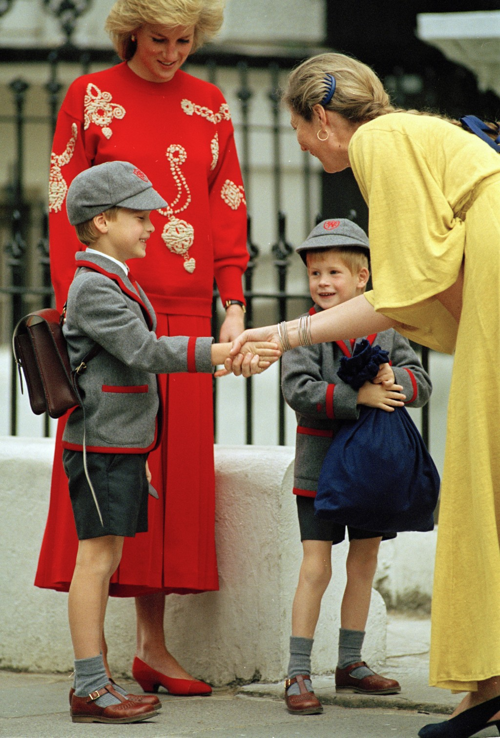 FILE - In this Sept. 11, 1989 file photo, Britain's Prince William gets a handshake from Frederika Blair-Turner, the headmistress of Wetherby School i...