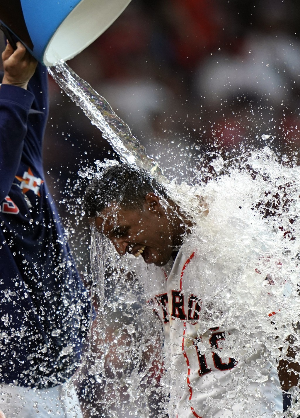 Houston Astros' Tony Kemp (18) is doused with water by Lance McCullers Jr. after hitting the game-winning home run against the Cleveland Indians durin...