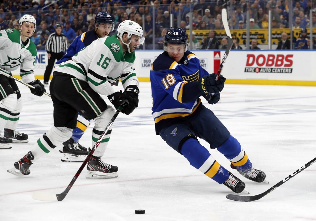 Dallas Stars' Jason Dickinson (16) and St. Louis Blues' Vladimir Tarasenko, of Russia, chase after the puck during the second period in Game 2 of an N...