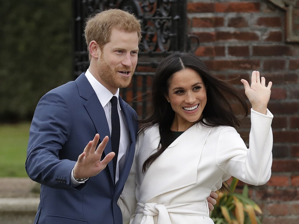 FILE - In this Monday, Nov. 27, 2017 file photo, Britain's Prince Harry and his fiancee Meghan Markle pose for photographers during a photocall in the...