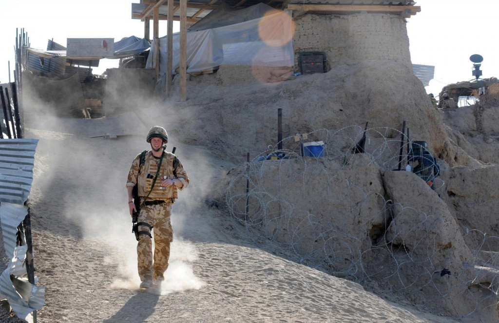 FILE In this Jan. 2, 2008 file photo, Britain's Prince Harry on patrol through the deserted town of Garmisir close to FOB (forward operating base) Del...
