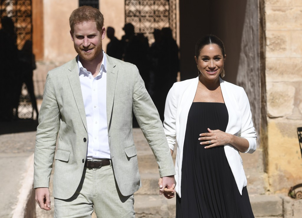 FILE - In this Monday, Feb. 25, 2019 file photo, Britain's Prince Harry and Meghan, Duchess of Sussex visit the Andalusian Gardens in Rabat, Morocco, ...