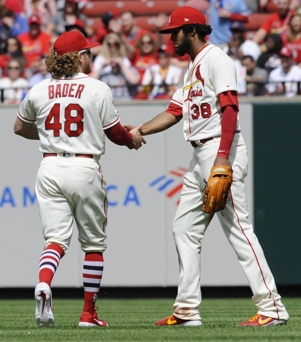 St. Louis Cardinals' Harrison Bader (48) replaces Jose Martinez (38) in right field against the Cincinnati Reds in the sixth inning of a baseball game...