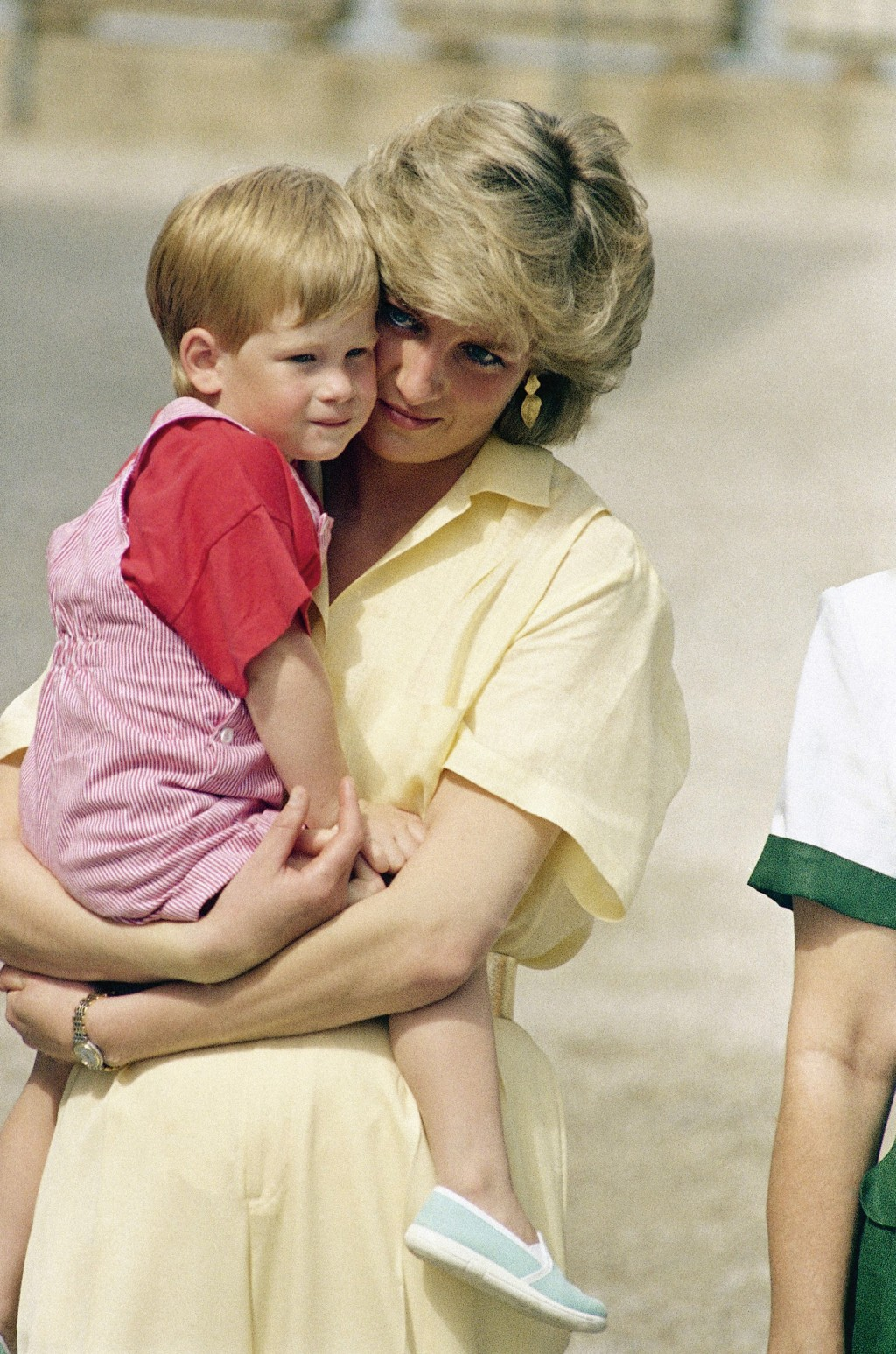 FILE - In this Sunday, Aug. 9, 1987 file photo, Diana, the Princess of Wales holds son Prince Harry while royal families posed for photographers at th...