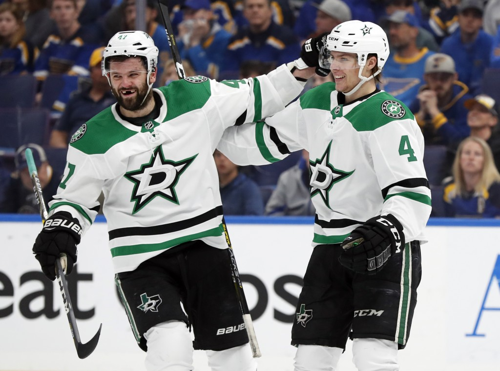 Dallas Stars' Miro Heiskanen (4), of Finland, is congratulated by Alexander Radulov after scoring during the first period in Game 2 of an NHL second-r