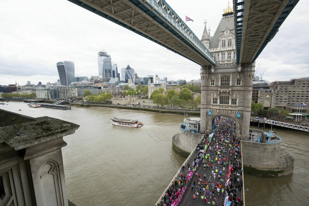 Runners take part in the 2019  London Marathon, over Tower Bridge in London, Sunday April 28, 2019. (Aaron Chown/PA via AP)