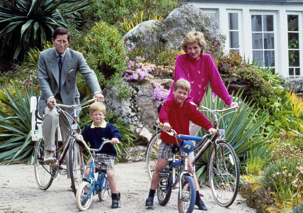 FILE - In this June 1, 1989 file photo, Britain's Prince Charles and Princess Diana and their sons, Princes William, right, and Harry begin a cycle ri...