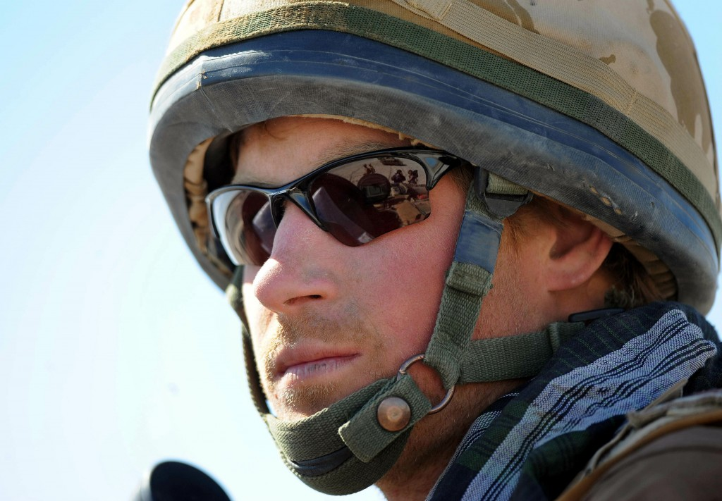 FILE - In this Feb. 18, 2008 file photo, Britain's Prince Harry, sits atop a military vehicle in the Helmand province, Southern Afghanistan. Princess ...