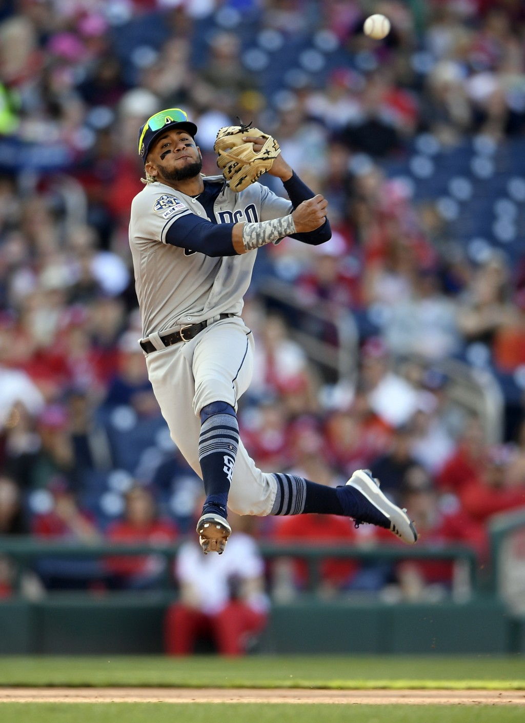 San Diego Padres shortstop Fernando Tatis Jr. throws to first to put out Washington Nationals' Adam Eaton during the sixth inning of a baseball game, ...
