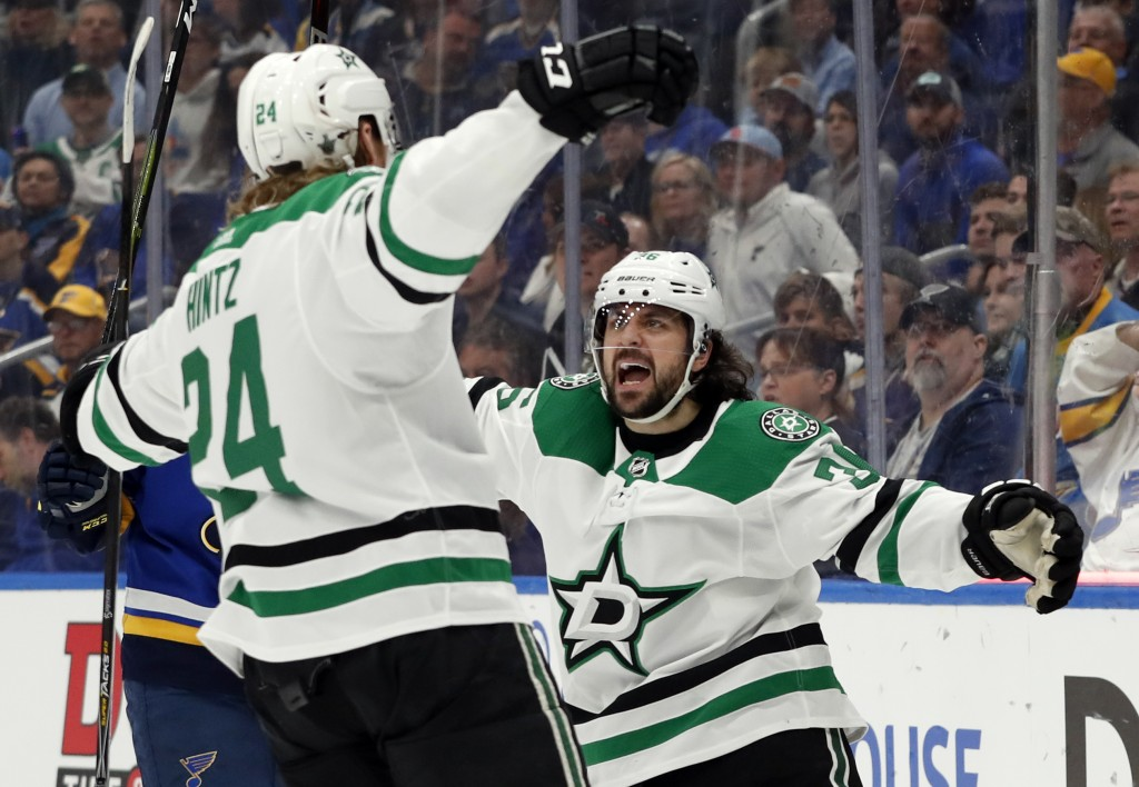 Dallas Stars' Roope Hintz, of Finland, is congratulated by Mats Zuccarello, right, after scoring during the first period in Game 2 of an NHL second-ro...