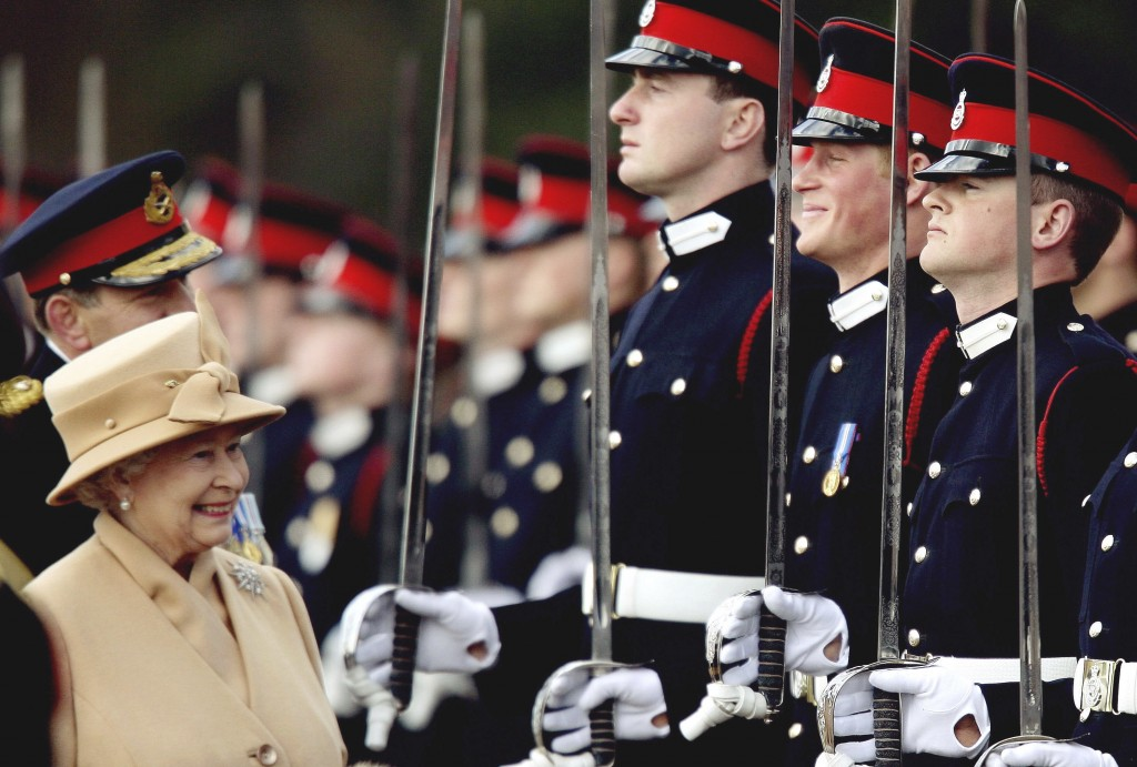 FILE - In this Wednesday, April 12, 2006 file photo, Britain's Prince Harry, second from right, grins and his grandmother Queen Elizabeth II smiles, a...