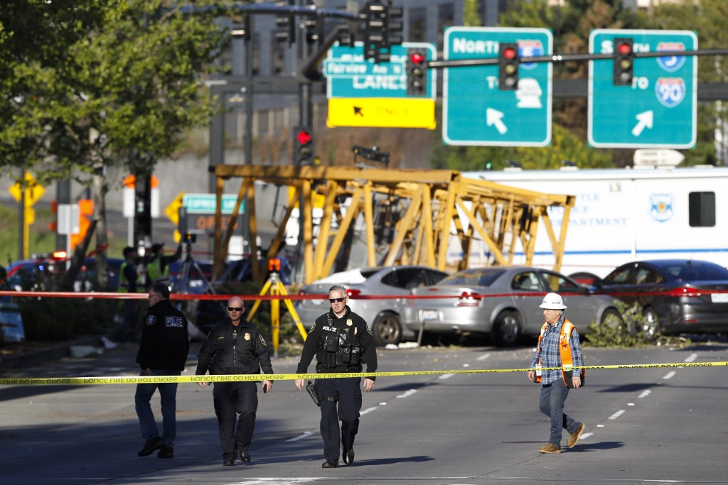 Emergency crews work at the scene of a construction crane collapse where several people were killed and others were injured Saturday, April 27, 2019, ...