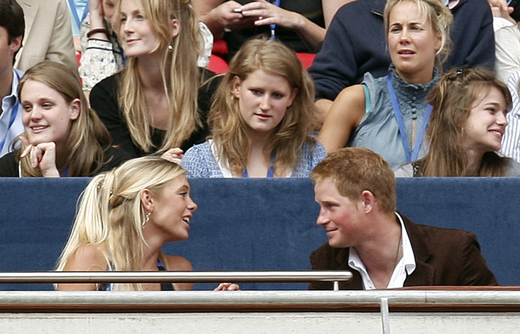 FILE - In this Sunday, July 1, 2007 file photo, Britain's Prince Harry, right, talks to his girlfriend Chelsey Davy at the Concert for Diana at Wemble...