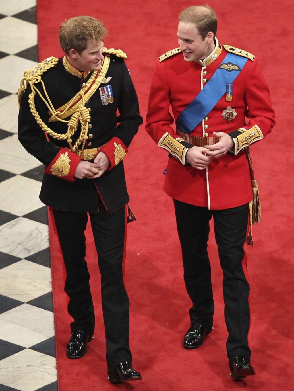 FILE - In this Friday, April 29, 2011 file photo, Britain's Prince Harry, left, best man to Britain's Prince William, right, arrive ahead of Prince Wi...