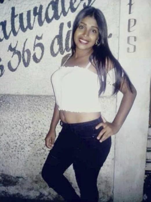 In this Jan. 2019, photo provided by Luisa Garcia, mother of Yubreilys Merchán, shows Merchan in Güiria, Venezuela. Merchán, a 23-year-old hairdresser...
