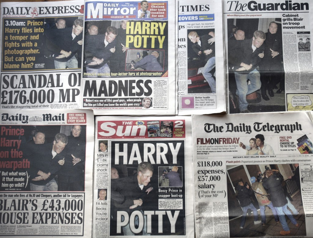 FILE - In this Friday, Oct. 22, 2004 file photo, a montage of the front pages of Britain's national newspapers  where photos of Prince Harry's alterca...