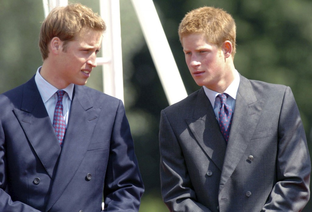 FILE - In this Tuesday, July 6, 2004 file photo, Britain's Princes William, left, and Harry talk at the opening of a fountain built in memory of their...