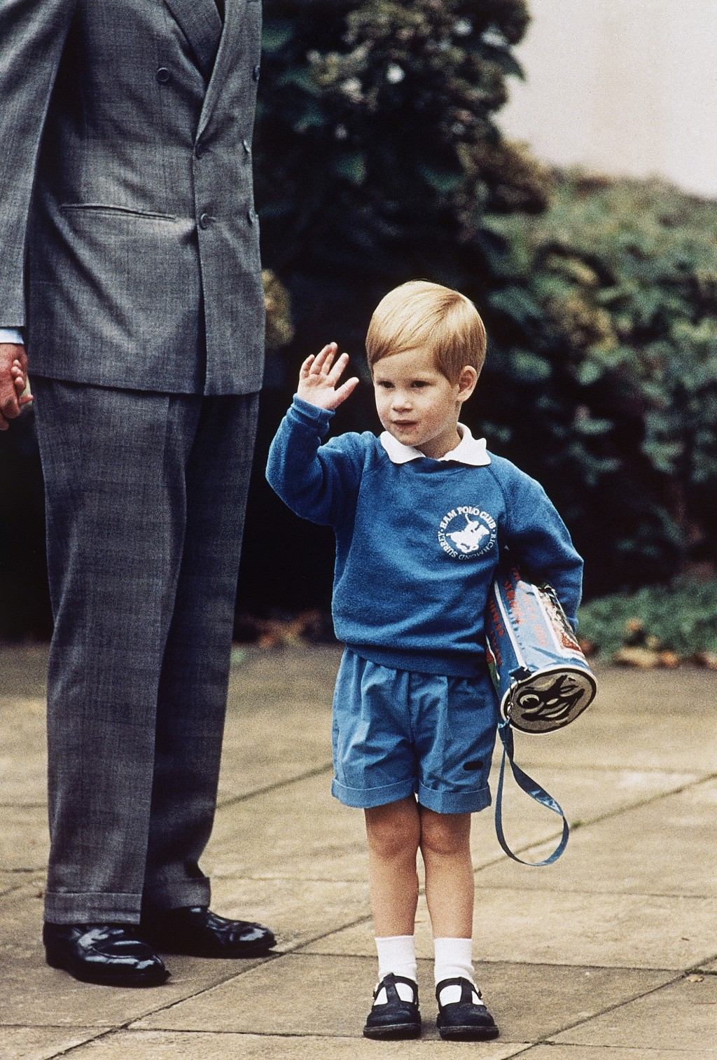 FILE - In this Sept. 16, 1987 file photo, Britain's Prince Harry waves to photographers on his first day at a kindergarten in Notting Hill, West Londo...