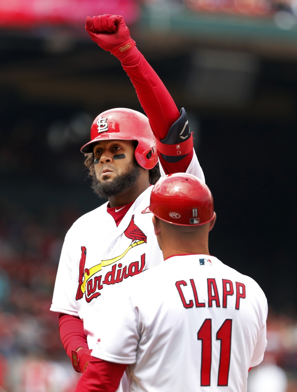 St. Louis Cardinals' Jose Martinez celebrates after hitting an RBI-single as first base coach Stubby Clapp (11) watches during the fourth inning of a ...