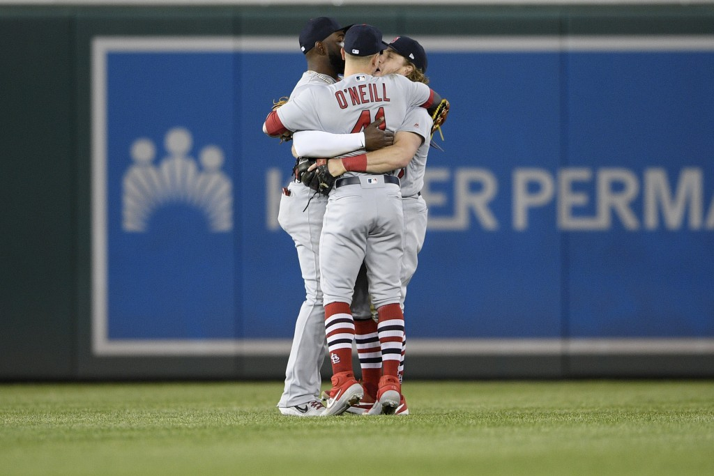St. Louis Cardinals' Marcell Ozuna, left, Tyler O'Neill (41) and Harrison Bader, right, celebrate after a baseball game against the Washington Nationa