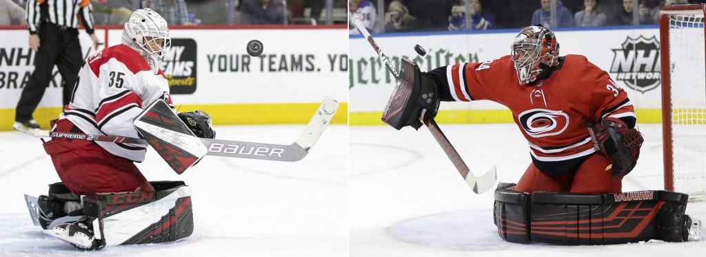 FILE - At left, in an April 6, 2019, file photo, Carolina Hurricanes' Curtis McElhinney keeps his eyes on the puck after making a save during the seco...