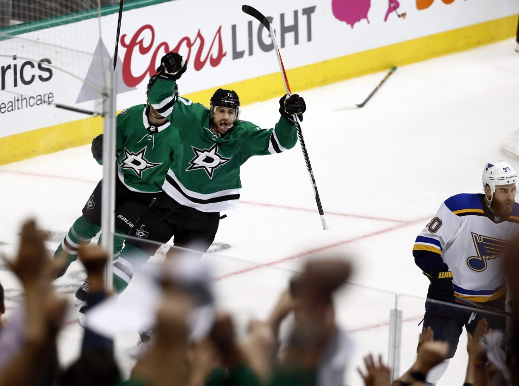 Fans, foreground, cheer as Dallas Stars center Andrew Cogliano (17) celebrates his goal in the third period of Game 3 of an NHL second-round hockey pl