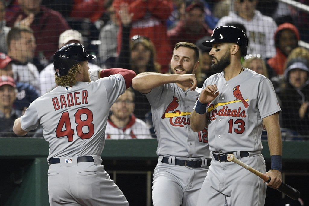 St. Louis Cardinals' Harrison Bader (48) celebrates his home run with Paul DeJong (12) and Matt Carpenter (13) during the fifth inning of a baseball g...