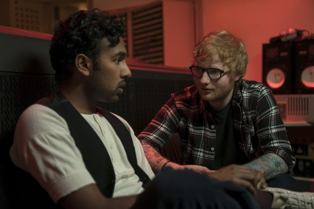 """This image released by Universal Pictures shows Himesh Patel, left, and Ed Sheeran in a scene from """"Yesterday,"""" directed by Danny Boyle. (Jonathan Pri..."""