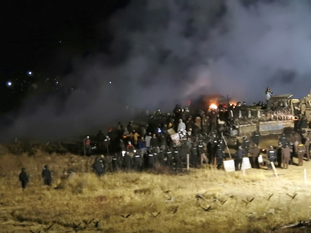 FILE - In this Nov. 20, 2016 file photo, provided by Morton County Sheriff's Department, law enforcement and protesters clash near the site of the Dak...
