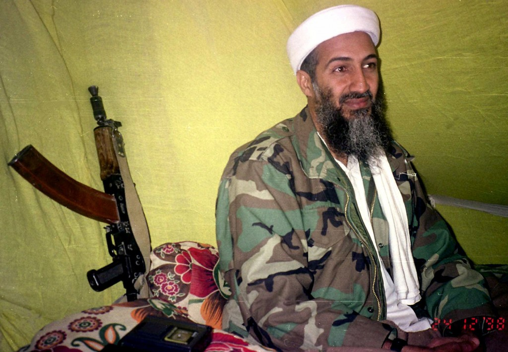 FILE - In this Dec. 24, 1998, file photo, al-Qaida leader Osama Bin Laden speaks to a selected group of reporters in mountains of Helmand province in