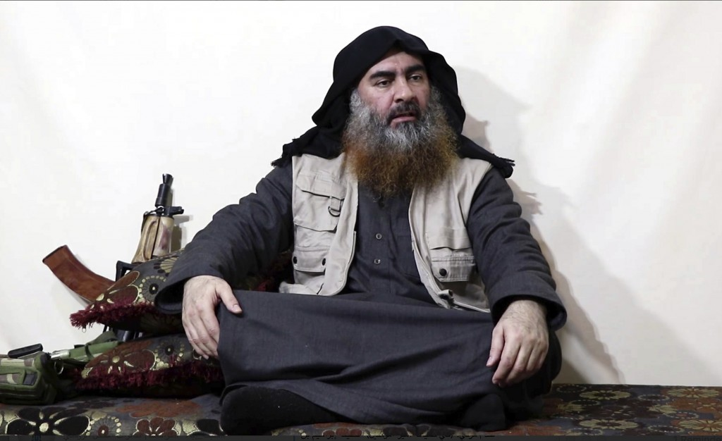 FILE - This file image made from video posted on a militant website Monday, April 29, 2019, purports to show the leader of the Islamic State group, Ab...