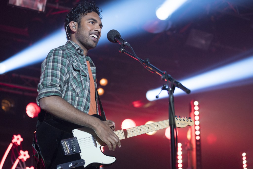 """This image released by Universal Pictures shows Himesh Patel in a scene from """"Yesterday,"""" directed by Danny Boyle. (Jonathan Prime/Universal Pictures ..."""
