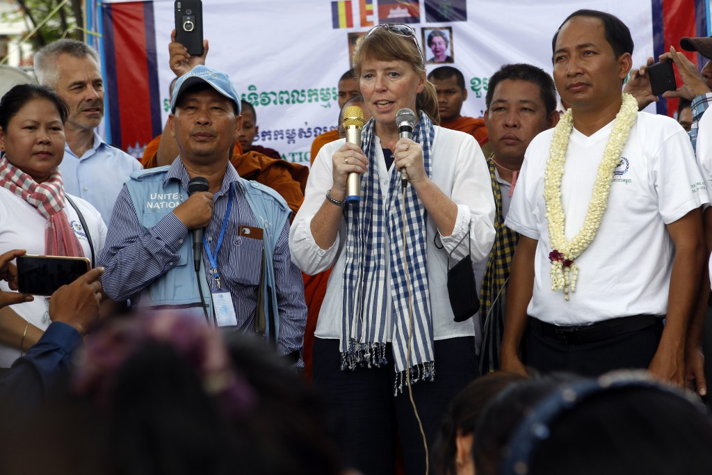 U.N. Special Rapporteur on Human Rights in Cambodia Rhona Smith, center, delivers a speech as Ath Thun, right, president of the Coalition of Cambodian