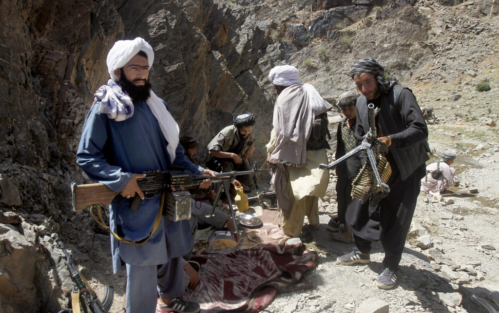 FILE - In this In this May 27, 2016, file,  photo, members of a breakaway faction of the Taliban fighters prepare to guard a gathering , in Shindand d