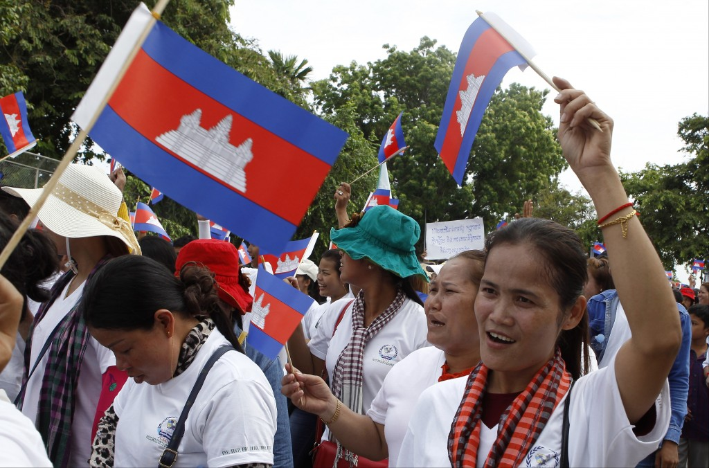 Cambodian workers march as they a gather to mark May Day near Wat Phnom, center of Phnom Penh, Cambodia, Wednesday, May 1, 2019. Some hundreds of work