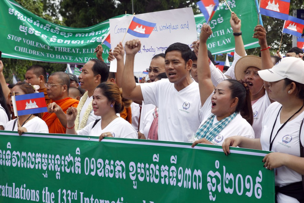 Cambodian workers march as they gather to mark May Day at Wat Phnom, center of Phnom Penh, Cambodia, Wednesday, May 1, 2019. Some hundreds of workers