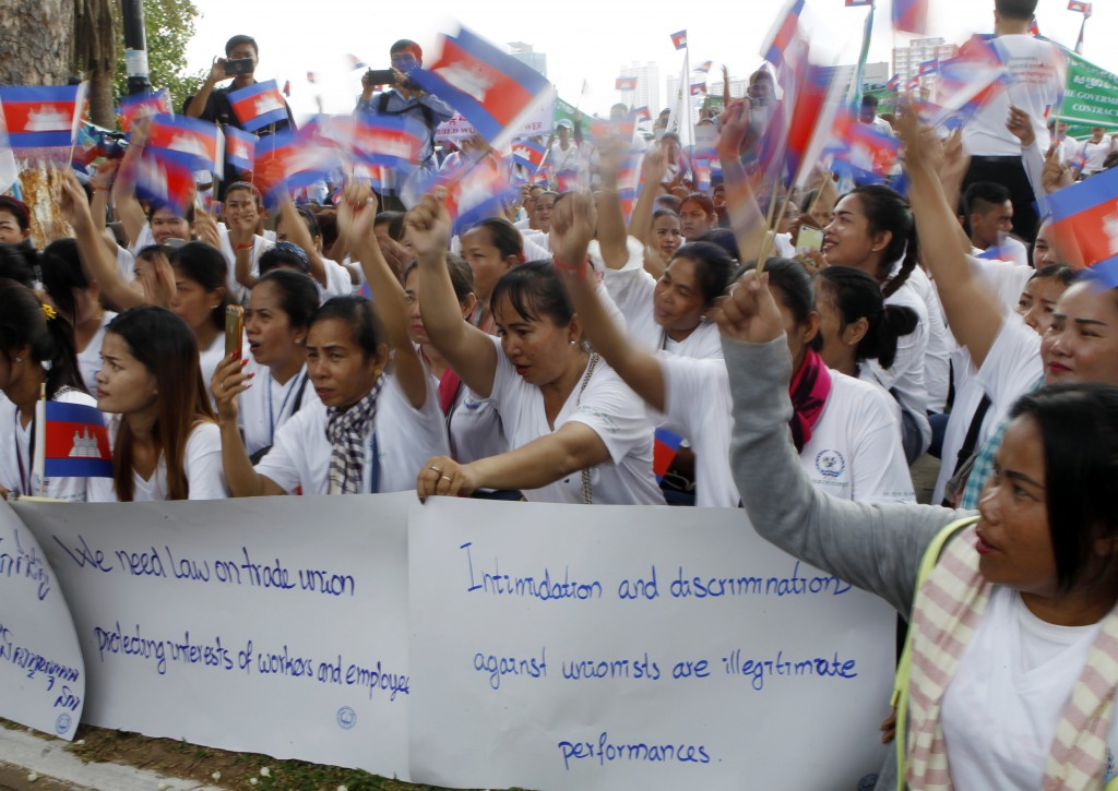 Cambodian workers gather to mark May Day at Tonle Sap river bank, in Phnom Penh, Cambodia, Wednesday, May 1, 2019. Some hundreds of workers staged a r...