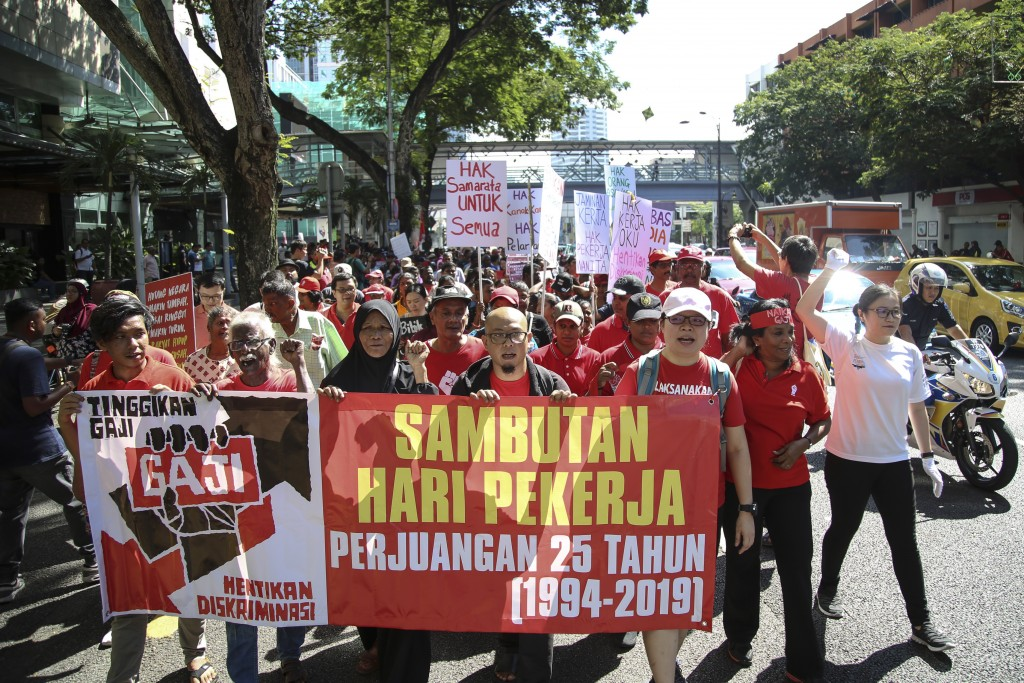 Malaysian workers stage a rally marking May Day in Kuala Lumpur, Malaysia, Wednesday, May 1, 2019. Hundreds of workers demand raise of basic salary an
