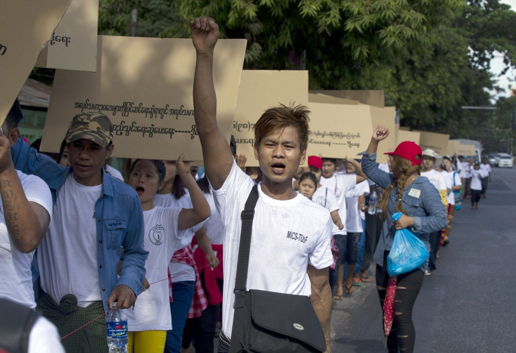 Myanmar workers shout slogan during a marching ceremony Wednesday, May 1, 2019, in Yangon, Myanmar. Hundreds most of factory workers marched Wednesday...