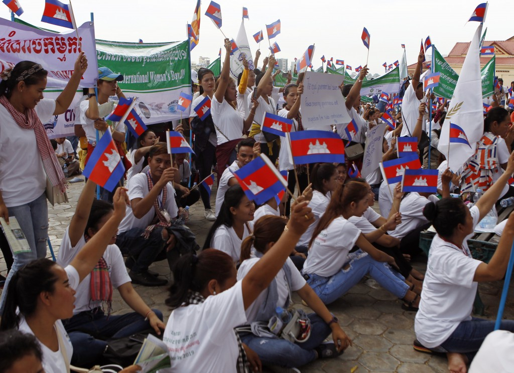Cambodian workers stage a rally marking May Day at Tonle Sap river bank, in Phnom Penh, Cambodia, Wednesday, May 1, 2019. Some hundreds of workers sta...
