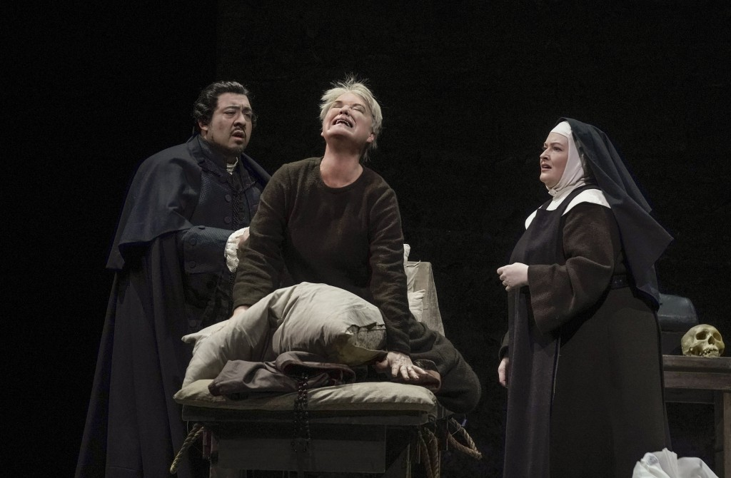 This image released by the Metropolitan Opera shows soprano Karita Mattila, center, Paul Corona, left, and Karen Cargill during a performance of Poule...