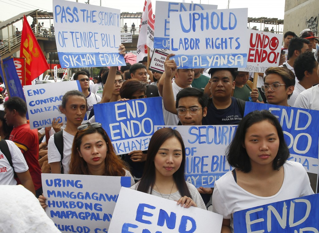 Protesters, mostly workers, gather for a rally prior to marching towards the Presidential Palace in Manila to pay tribute to workers in celebration of