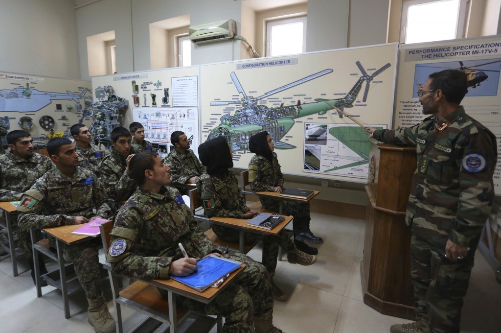FILE - In this Nov. 21, 2016 file photo, new Afghan air force pilots attend class at the air force university in Kabul, Afghanistan. Afghanistan may n