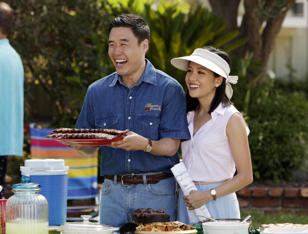"""In this image released by ABC, Randall Park, left, and Constance Wu appear in a scene from the new comedy series """"Fresh Off the Boat."""" The Asian Pacif..."""