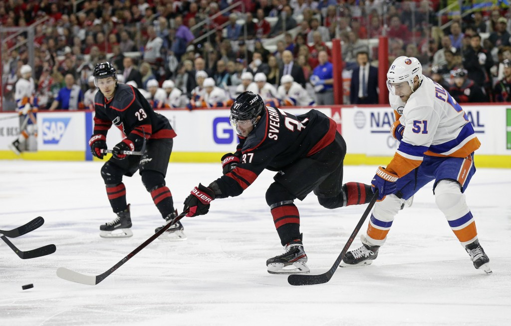 Carolina Hurricanes' Andrei Svechnikov (37), of Russia, chases the puck with New York Islanders' Valtteri Filppula (51), of Finland, during the first ...